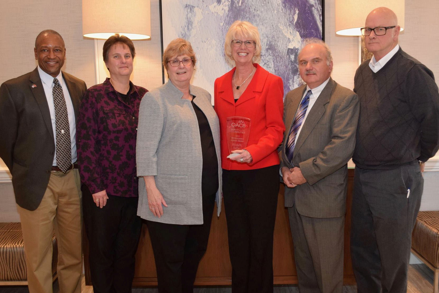 Prather honored with Distinguished Service Award from OACB